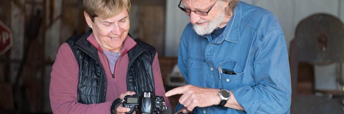Chris Harris teaching student at photography workshop