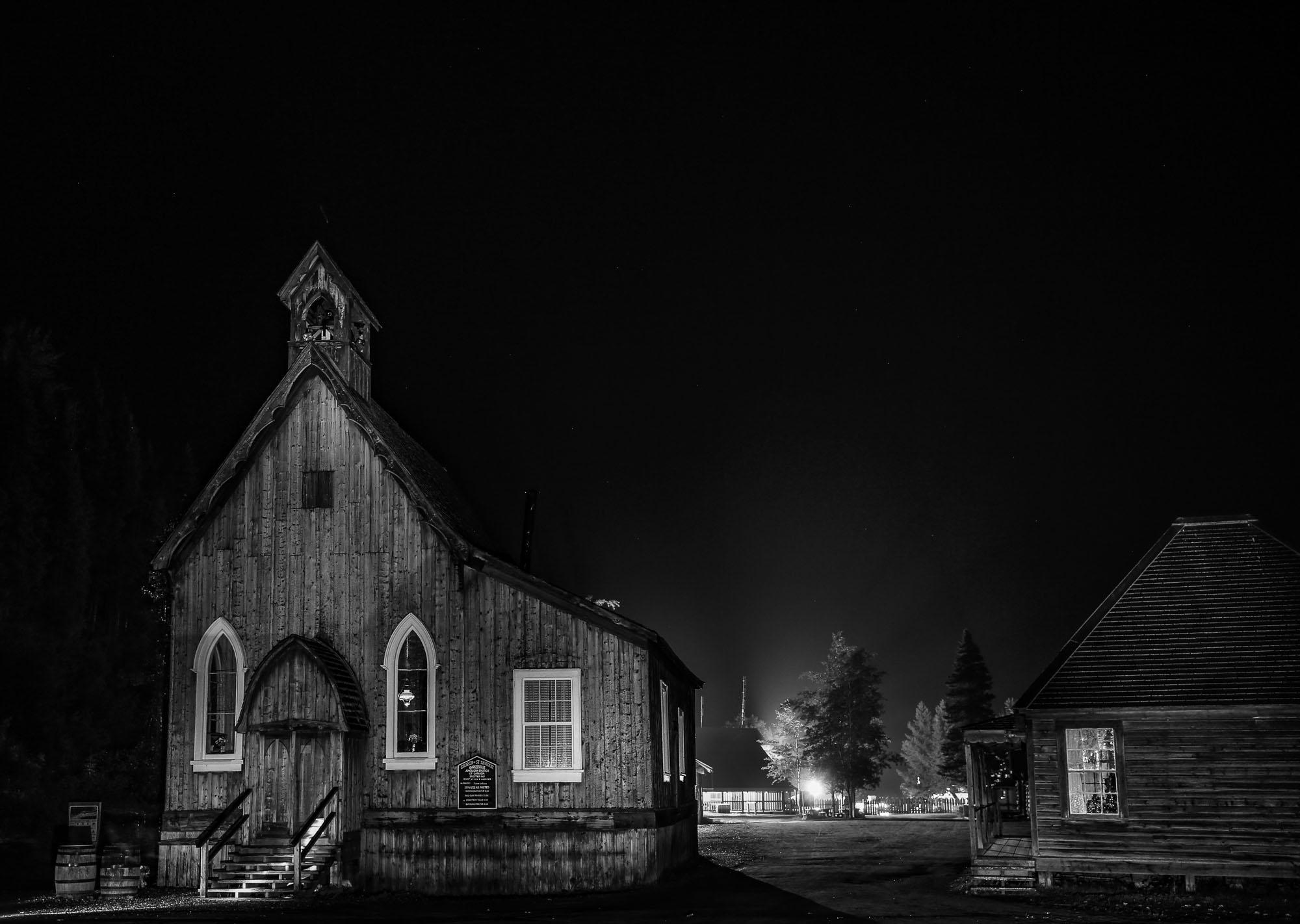 Historic Barkerville church on the Main street at night.