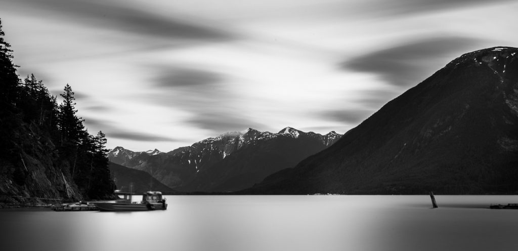 A long exposure image at Develop Your Creative Vision creative photography workshops makes the sea appear calm.
