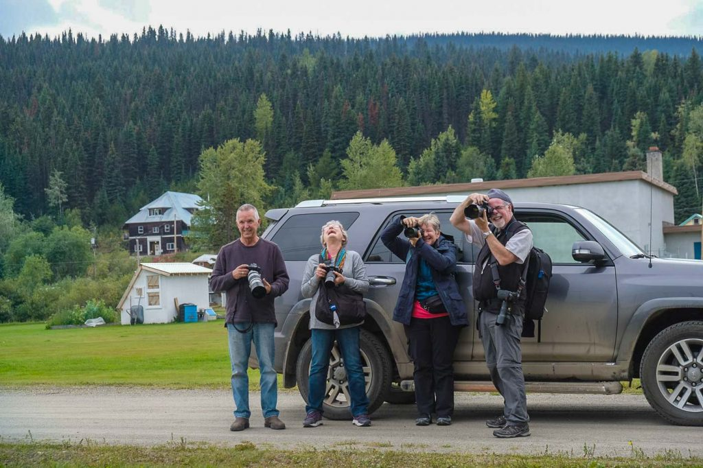 Creative photography workshop participants laugh and learn together in Barkerville BC Canada