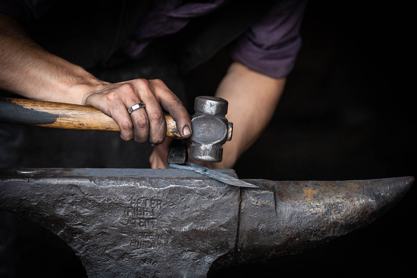 Blacksmith at work during artistic photography workshop, Barkerville, BC, Canada